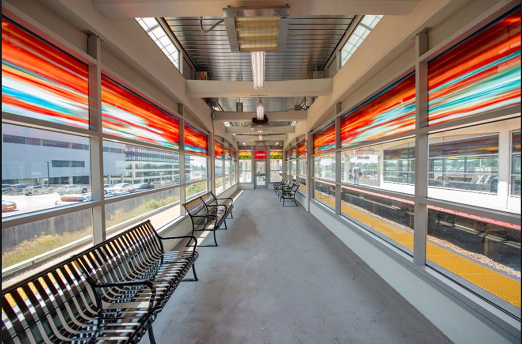 Hicksville Station, Eastbound Waiting Room 1 Sumac, art glass. (total length 50 Ft.), installed 2018, commissioned by MTA Arts & Design.