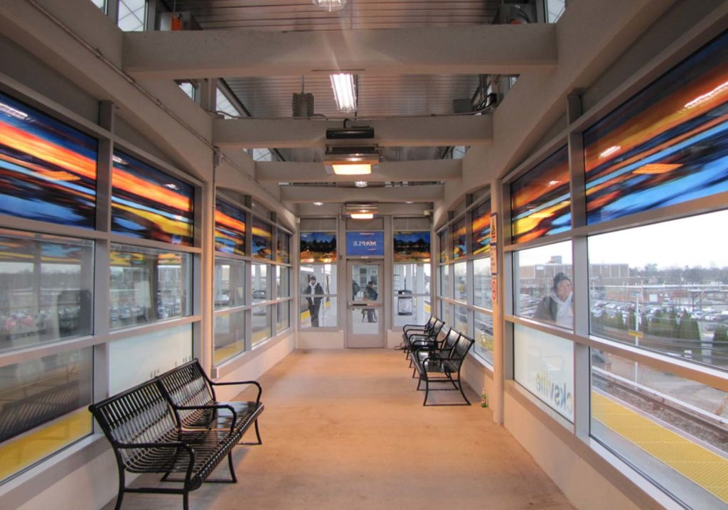 Hicksville Station, Westbound, Waiting Room 4, Maple, art glass. (total length 50 Ft.), installed 2018, commissioned by MTA Arts & Design. Photo, Patrick Cashin.