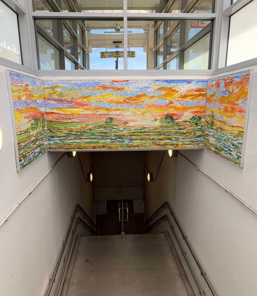 Hicksville Station, Eastbound Staircase, Sunset, Hempstead Plain, glass mosaic, installed 2019, commissioned by MTA Arts & Design. Photo, Stephen Miotto.